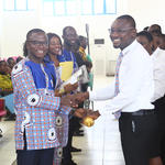 The New GRASAG President, Mr. Albert Awortwi Sagoe, receiving the symbol of office from Mr. Geoge Sarfo, the immediate past GRASAG President